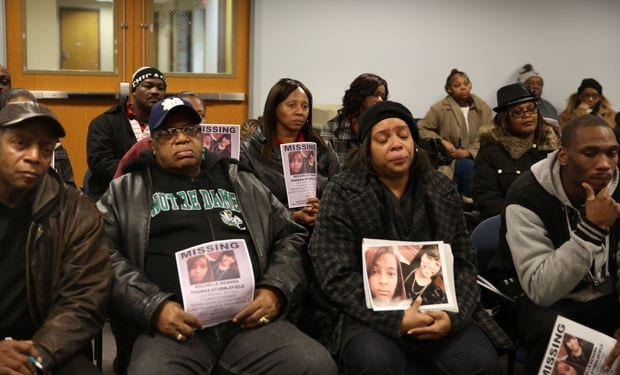Thelma Thomas, second from right, of Merrillville, mother of missing person Rochelle Thomas Stubblefield, listens to investigators Friday during a news conference seeking the public's help in the case. -Damian Rico/Photo (The Times)